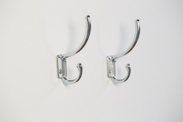 Empty hooks attached on wall
