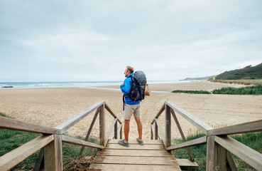Alone traveler on the ocean beach