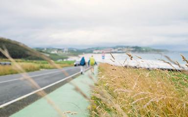 Two backpacker travelers walk on road