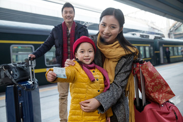 Happy family at the station platform