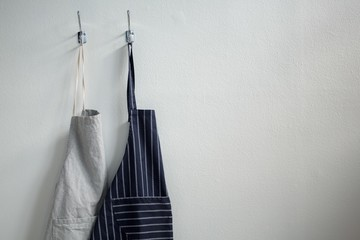 Aprons hanging on hook