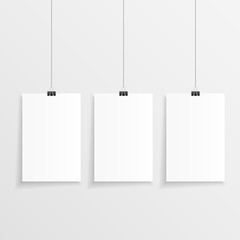 Realistic hanging paper set with three step and clips. Vector illustration of three blank papers with space for text in front of a wall.