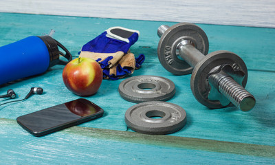Sports accessories for fitness on the blue floor