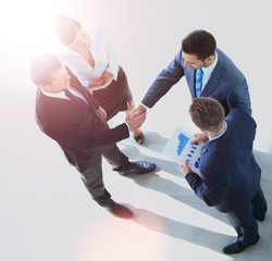 Top view of a successful business leaders finalizing a deal at office