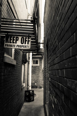 Ally Way with Keep Off Sign