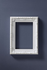 Empty picture frame on dark background