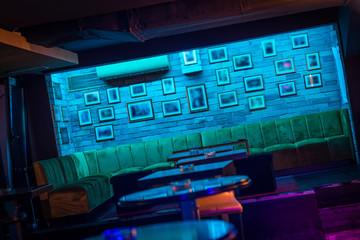 Big luxury sofa and brick wall in restaurant interior