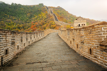 China The great wall distant view compressed towers and wall segments autumn season in mountains near Beijing ancient chinese fortification military landmark in Beijing, China.