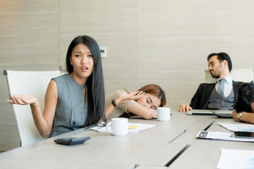 Bored business people and sleeping resting on workplace during work meeting, concept of exhausted businesspeople bored sleep tired.