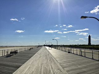 Looking Down the Jones Beach Boardwalk with the Suns Rays Shining Down at Jones Beach State Park, Long Island, New York