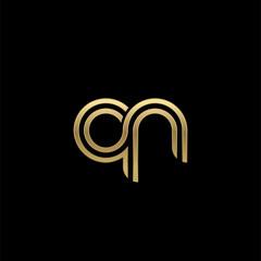 Initial lowercase letter qn, linked outline rounded logo, elegant golden color on black background