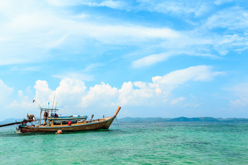 Longtail boats floating on the Sea at Phuket, Thailand. Summer, Travel, Vacation and Holiday concept.