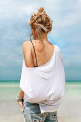 stylish fashion model posing on beach