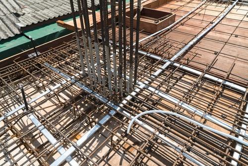 Steel rebar reinforcement in post tension slab concrete in