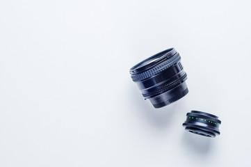 Old lenses on white background