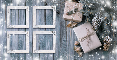 Christmas background with gift box and frames on wooden planks
