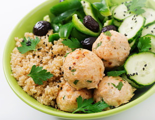 Baked meatballs from turkey fillet with garnish of quinoa and salad from fresh vegetables. Proper nutrition. Sports nutrition. Dietary menu