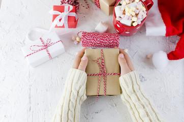 baby packs a handmade gift. Christmas gifts,