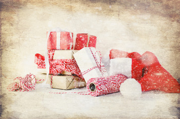 Gift boxes tied with a red ribbon , fir branches,
