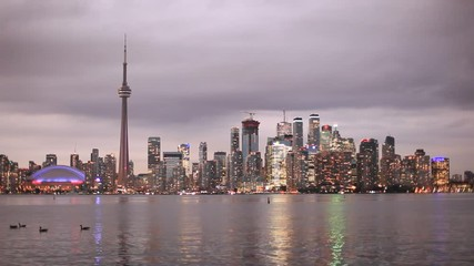 Wall Mural - Toronto downtown skyline illuminated at twilight. Province of Ontario, Canada