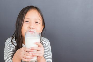 Asian kid cute girl  happy to drink milk