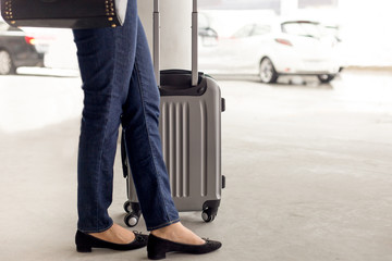 Woman tourist standing with luggage waiting for taxi