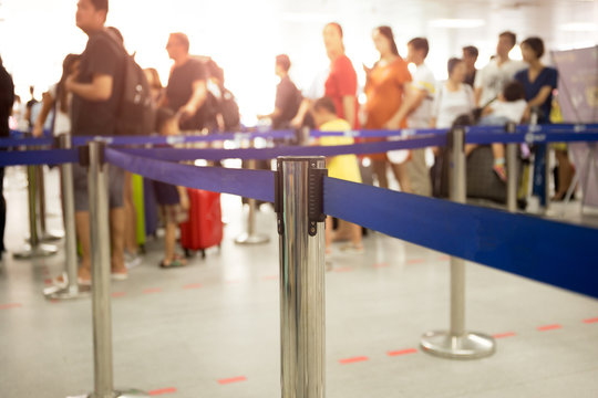 passengers check-in line at the airport