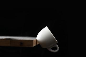 Falling coffee cup