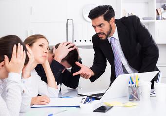 Irritated boss scolding subordinates