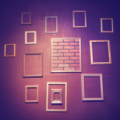 Beautiful empty picture frames hanging on the wall