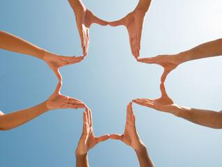 Hands making a Cross