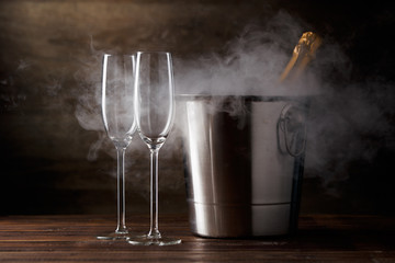 Image of two glasses with champagne, iron bucket