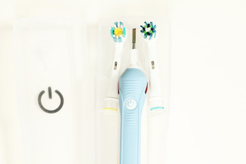 Electric toothbrush isolated on white with travel case background close up photo