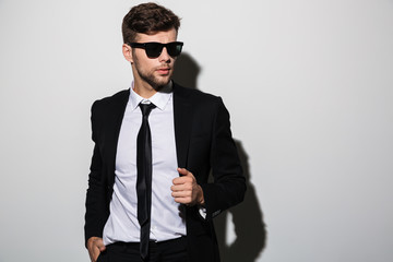 Portrait of a handsome stylish man in suit