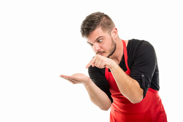 Supermarket employer pointing something in his palm