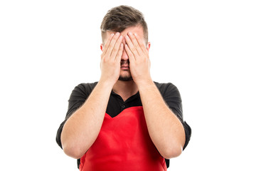 Male supermarket employer covering eyes like not seeing
