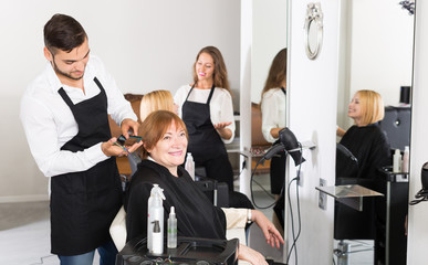 Barber makes the cut for  woman