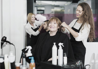 Elderly woman smiling at the hair salon