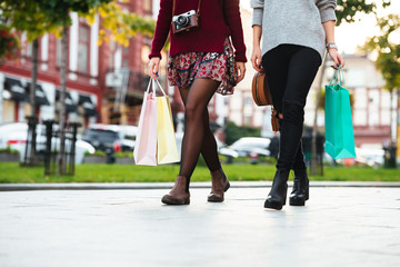 Cropped image of two young girls walking on a city street
