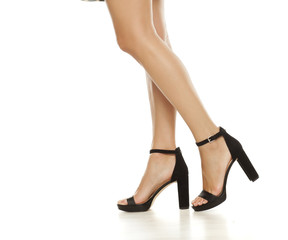 beautiful legs, and high heels on white background