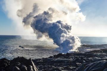 Eruption of a volcano on the Hawaiian island on the ocean. Volcanic activity. Tourism. Field of frozen black lava