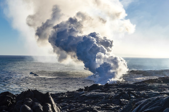 Eruption of a volcano on the Hawaiian island on the ocean. Volcanic activity. Tourism. Field of frozen black lava