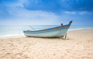 Little boat on the beach with the storm background Wall mural