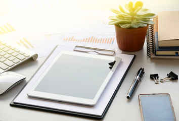 mock up tablet blank screen on the desk in interior modern office,space for your text.