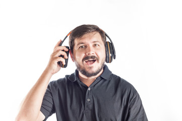 Portrait of 30 years old caucasian man enjoy to listen music from headphones