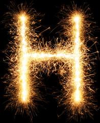 Sparkler firework light alphabet H isolated on black