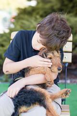 Happy boy portrait, boy and dog in love.