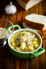 chicken soup with pearl barley in a bowl