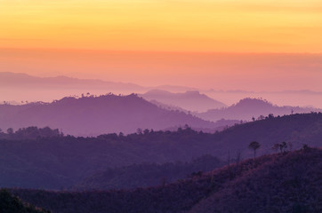 Poster Hill sunrise high angle view in early morning over rainforest mountain in thailand