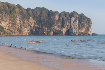 view of tropical beach during low tide at Ao Nang beach on andaman sea Krabi, Thailand at afternoon time .